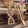 Pearl diamond bow