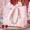 Bolsa rosa con cinta rosa
