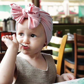 Spring and summer new baby hat European and American children's solid color drape flowers India hat cover head hat wholesale chi