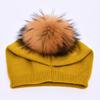 Yellow with fur pom pom