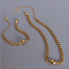 Necklace gold color with green eye
