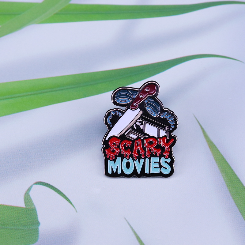 Scary movies enamel pin with classic VHS knife and phone bloody horror fans perfect spooky art addition