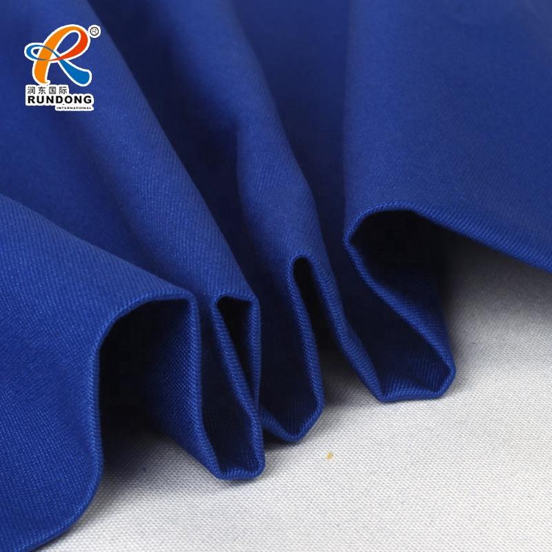 Peach fabric cotton twill in 65% cotton 35% polyester