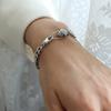 bracelet steel color with green eye