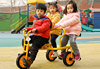 Triple seat tricycle for children