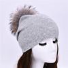light grey-match fur pom pom