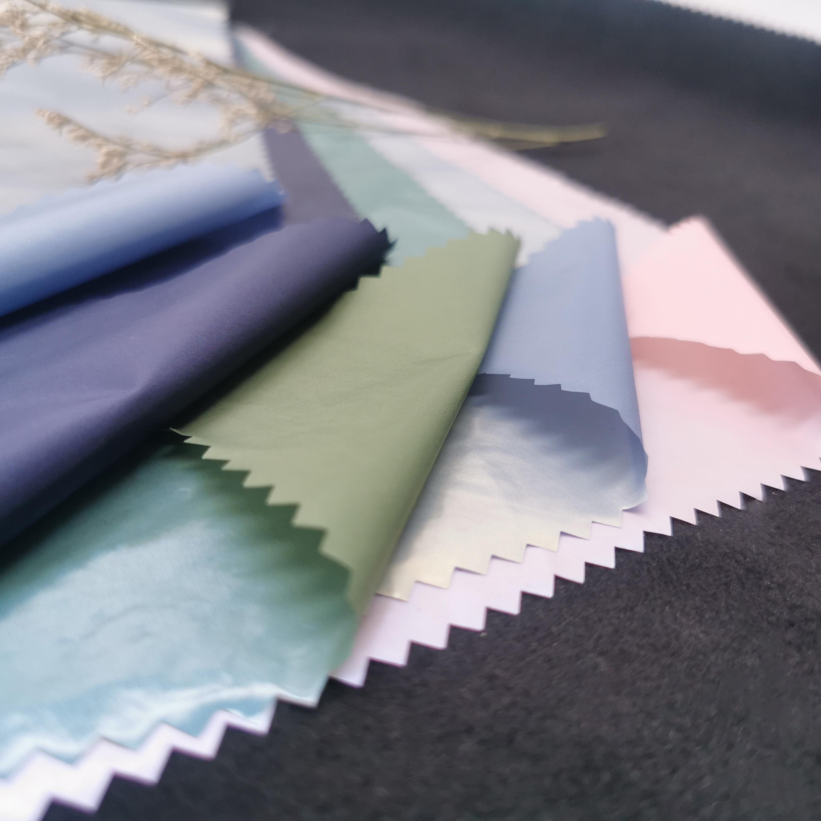 100% нейлоновая 380T Водонепроницаемая и пониженная нейлоновая ткань для сумок с симфоническим Blu-Ray жемчужным покрытием
