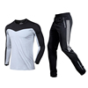 gray shirt with black white pants