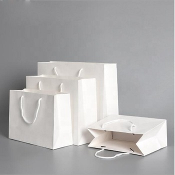 New gift portable clothing shopping bag ,White cardboard paper bag with handle