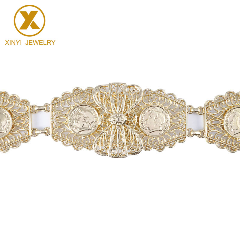 A shimmering metallic bow belt with men's heads and fashion jewelry with cutout sequins