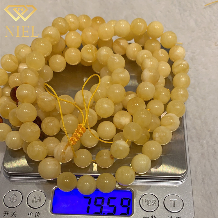 10-12mm Price of a gram natural white and yellow baltic amber stone loose ball beads necklace for sale