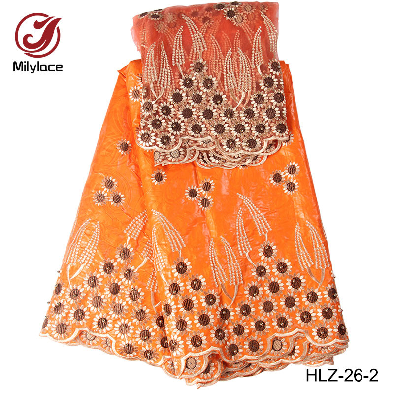 High quality new wholesale embroidery guinea jacquard brocade fabric women dress with beads