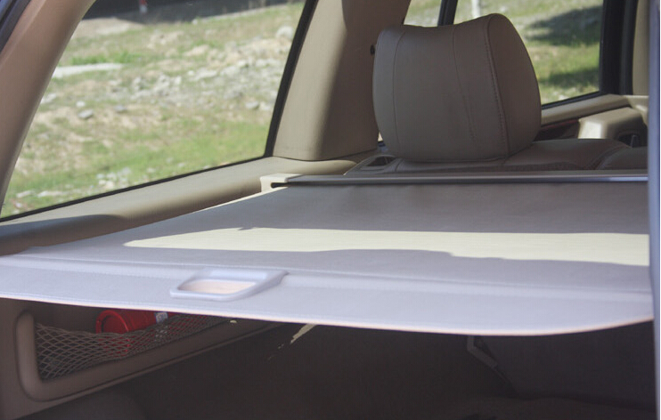 beige rear trunk security shield cargo cover for jeep grand cherokee 2014 2015 in chromium. Black Bedroom Furniture Sets. Home Design Ideas