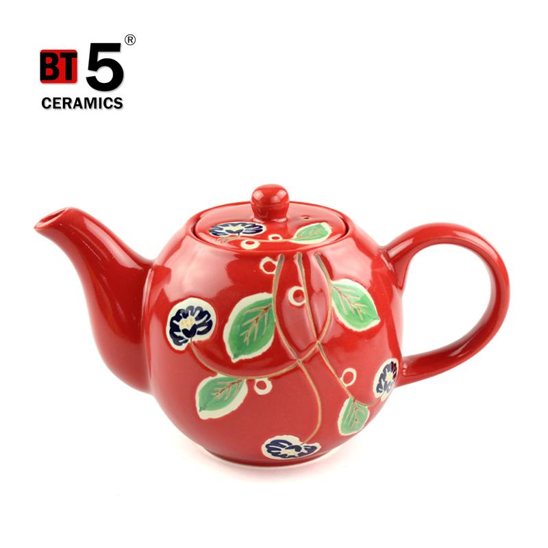 Wholesale hotel restaurant ceramic handle novelty teapot with unique pattern