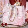Rosa bolsa de cinta gris