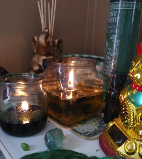 Flame on wick which is floating in the glass oil lamp FLOATING CANDLES