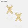 X - gold or rhodium