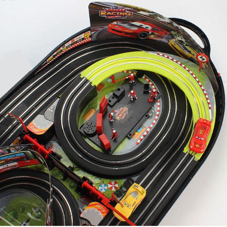 Оптовая продажа Детские орбиты игровые автоматы слот + игрушки гоночные автомобили комплект трек железной дороги электрический выключатель света, играть в игры, игрушки с дистанционным управлением