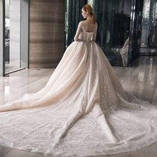 2020 роскошные новые дворцовые стильные свадебные платья трапециевидной формы с длинными рукавами и фатиновым шлейфом, яркое шелковое плать...(Китай)