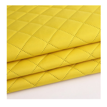 Polyester oxford fabric embossed with ultrasonic designs back side quilting with taffeta fabric or PE foam backing