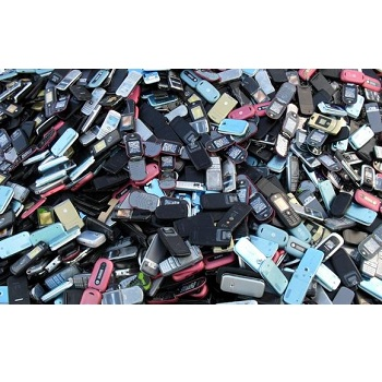 Old and refurbished mobile phones and motherboard scrap in Asia