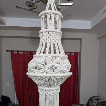cylindrical Macrame lamp shade made of natural cotton cord for home and garden decoration